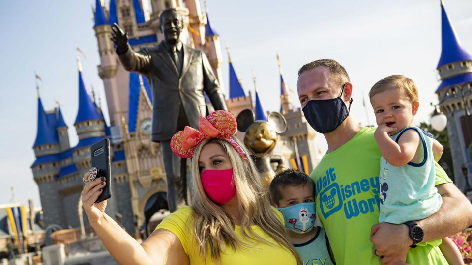 Walt Disney World Resort guests taking picture wearing face masks