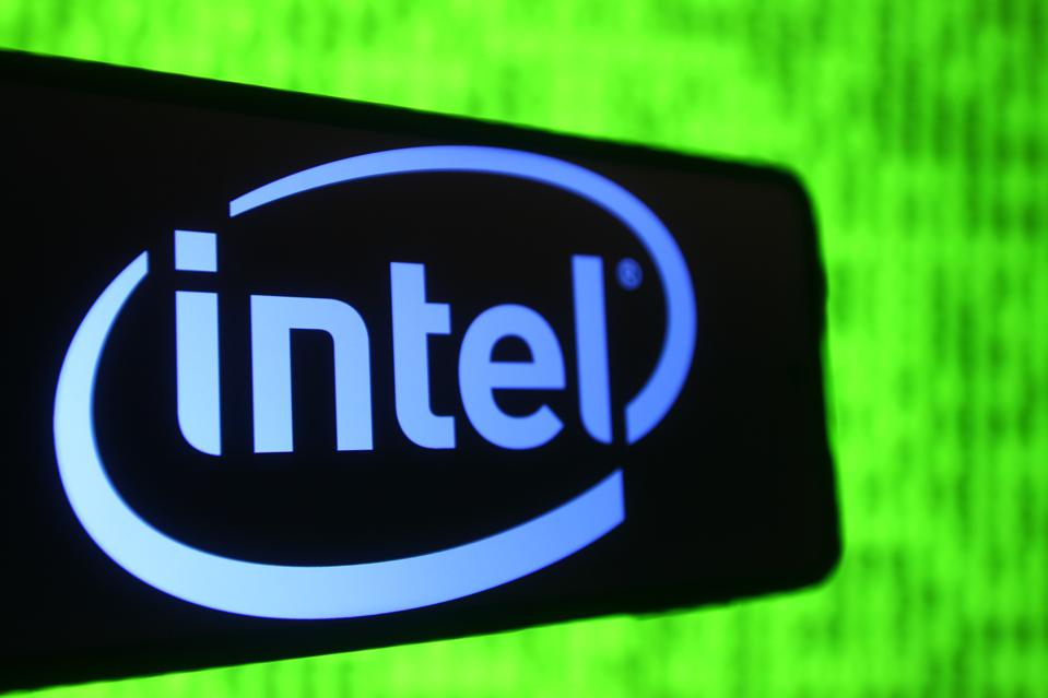In this photo illustration an Intel logo is seen on a...