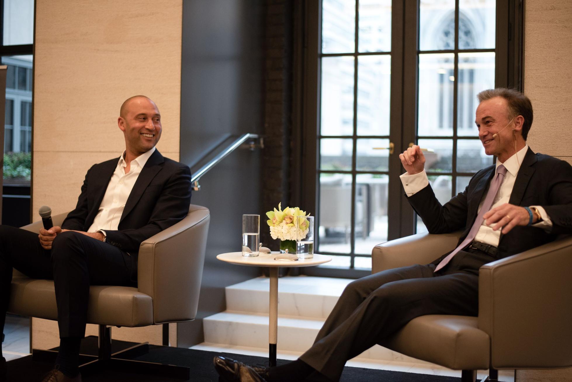 Derek Jeter and Greg Fleming pictured at a 2019 client event at Rockefeller's headquarters in Rockefeller Plaza.