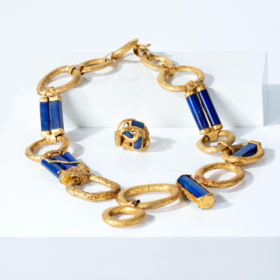 Boldly scaled lapis lazuli and 22-carat gold necklace and ring.