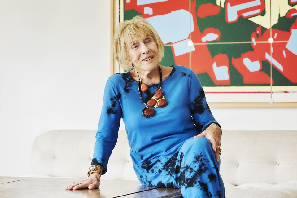 Jewelry connoisseur Mimi Lipton wears a rich red and black coral breastplate necklace.