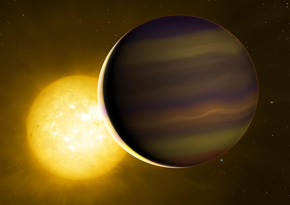 Exoplanet HD 209458b transits its star. The illuminated crescent and its colours have been exaggerated to illustrate the light spectra that the astronomers used to identify the six molecules in its atmosphere.
