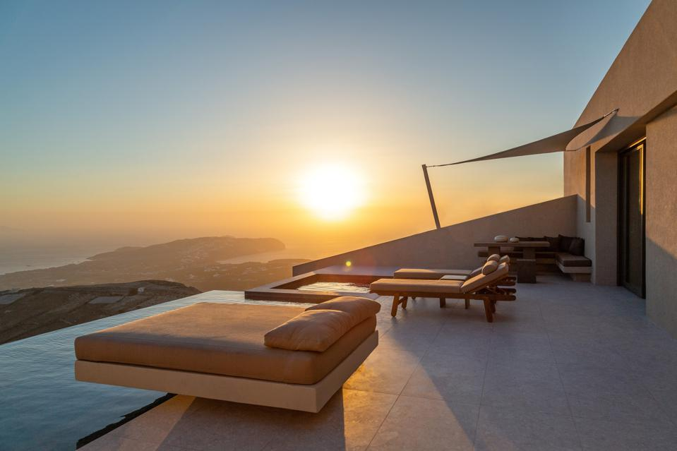 Two lounge chairs in the sunlight at Santorini Sky resort.