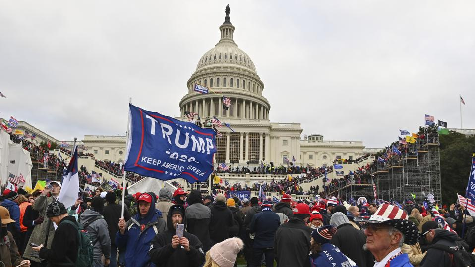 Protesters with Trump flag at U.S. Capitol building on Jan. 6