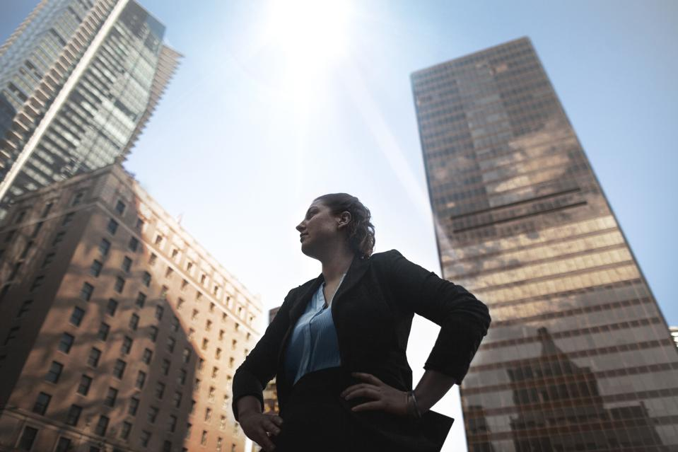 Low angle view of Caucasian businesswoman looking away at downtown cityscape