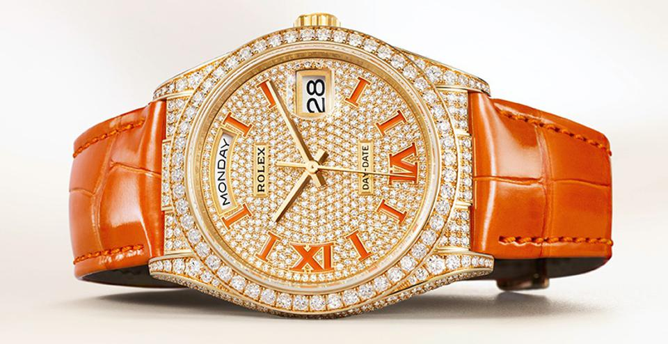 Diamond paved Rolex Day-Date 36 with coral enameled numerals and a coral alligator strap.