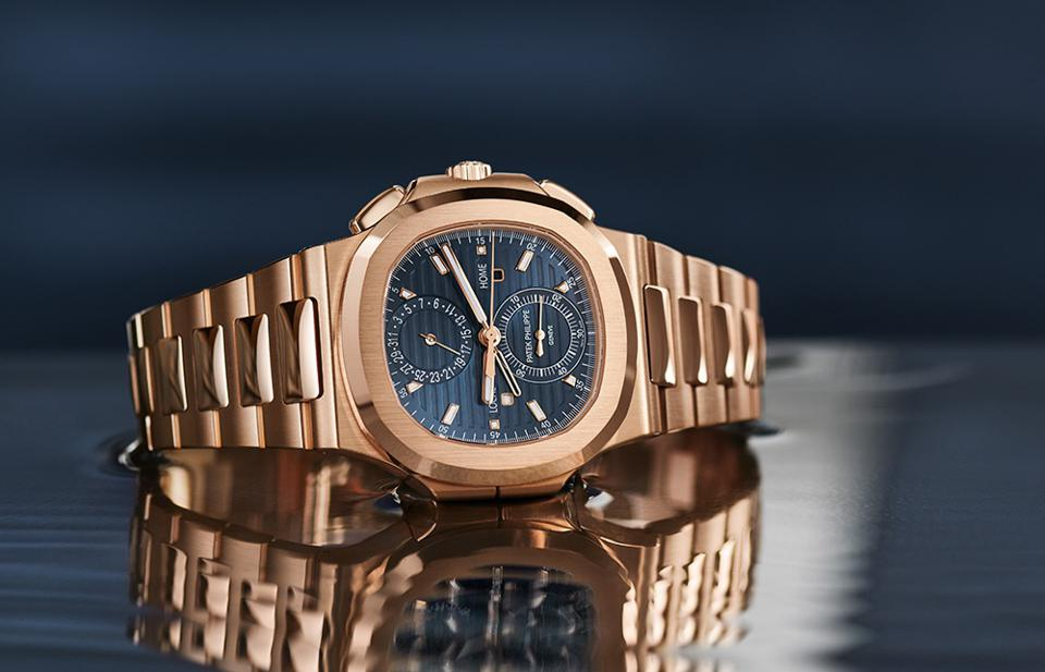 The red gold version of the Patek Philippe Nautilus Travel Time Chronograph.