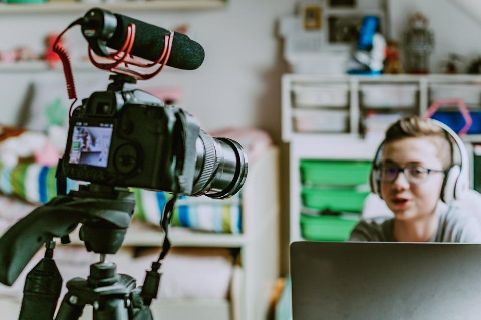 teenager boy making video vlogg at home during lockdown