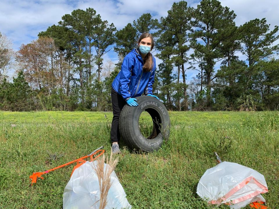 A volunteer stands by litter collected during an event with Keep Golden Isles Beautiful, located in Georgia.
