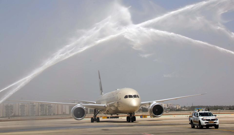 Etihad twin-engine jet gets water cannon salute at Ben Gurion Airport, Te Aviv, Israel.