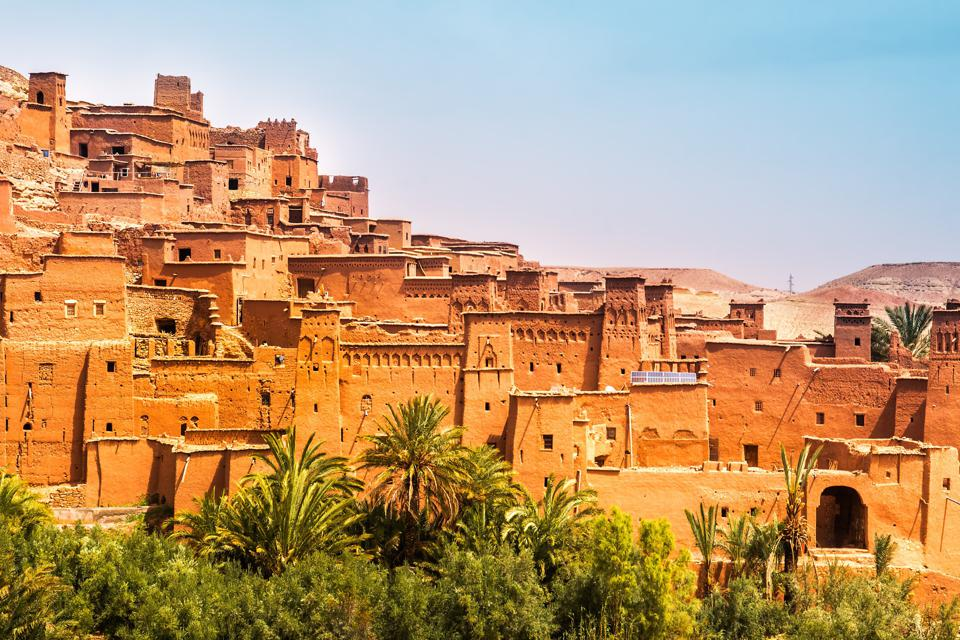 A mud brick red city in Morocco built on a hill