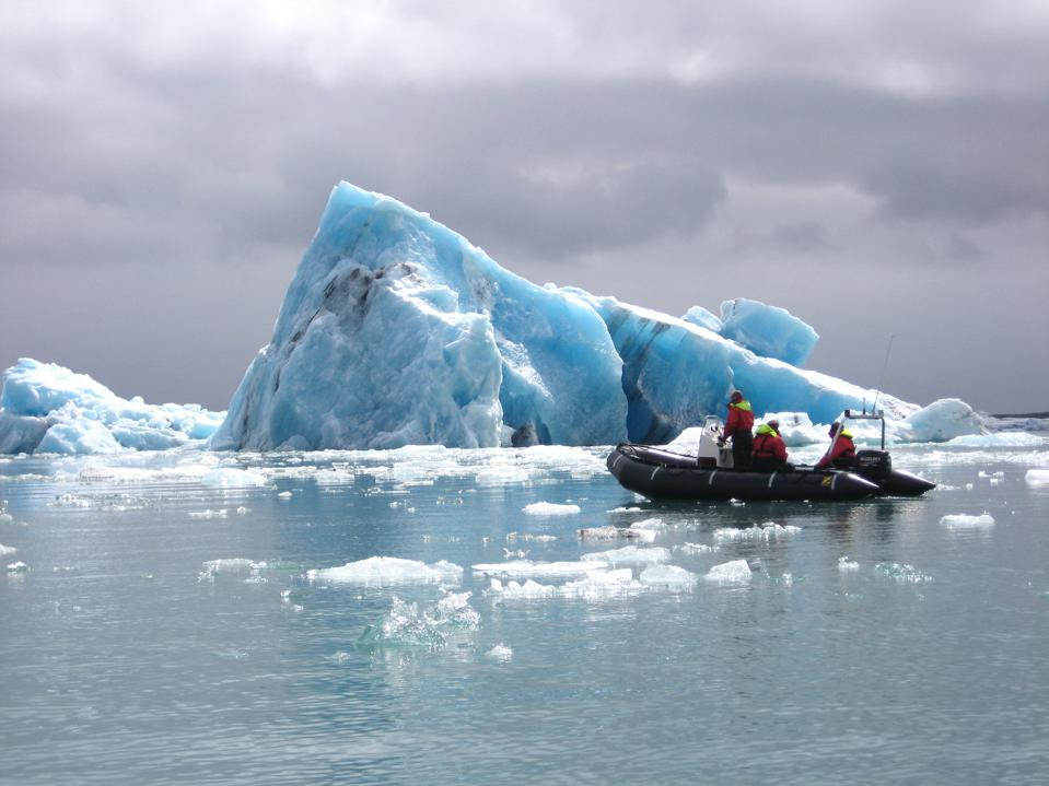 Skimming past icebergs in a Zodiac boat in Iceland.