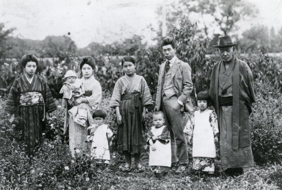 Kusama child with his family at their seed farm in Nagono, Japan