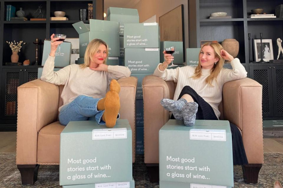 cameron diaz and Kat powers sit around boxes of their wine Avaline