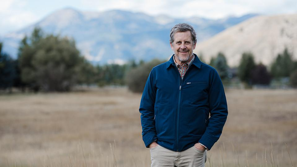 Stephen Sullivan, Stio founder, standing in front of Wyoming mountains.