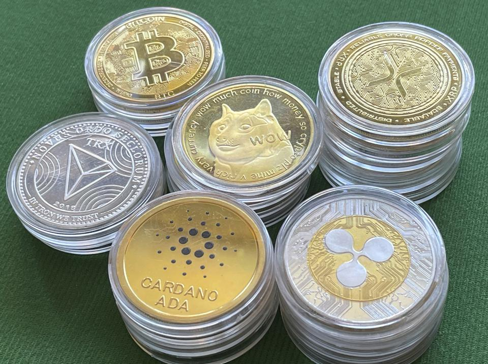 Physical representatives of cryptocurrency tokens as poker chips on green baize.