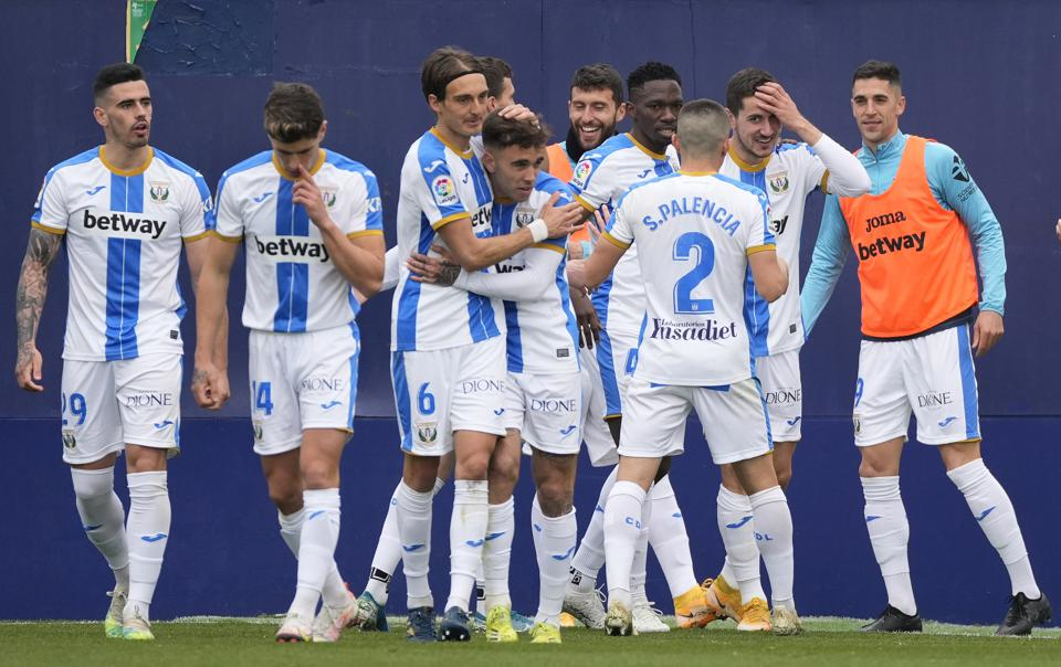 Leganés players embrace each other after scoring in the Spanish second division.