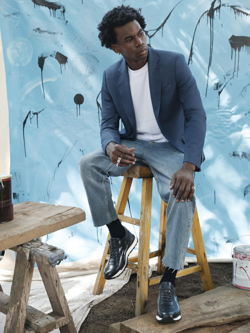Cavier Coleman in front of his painting, ″Moving Water″
