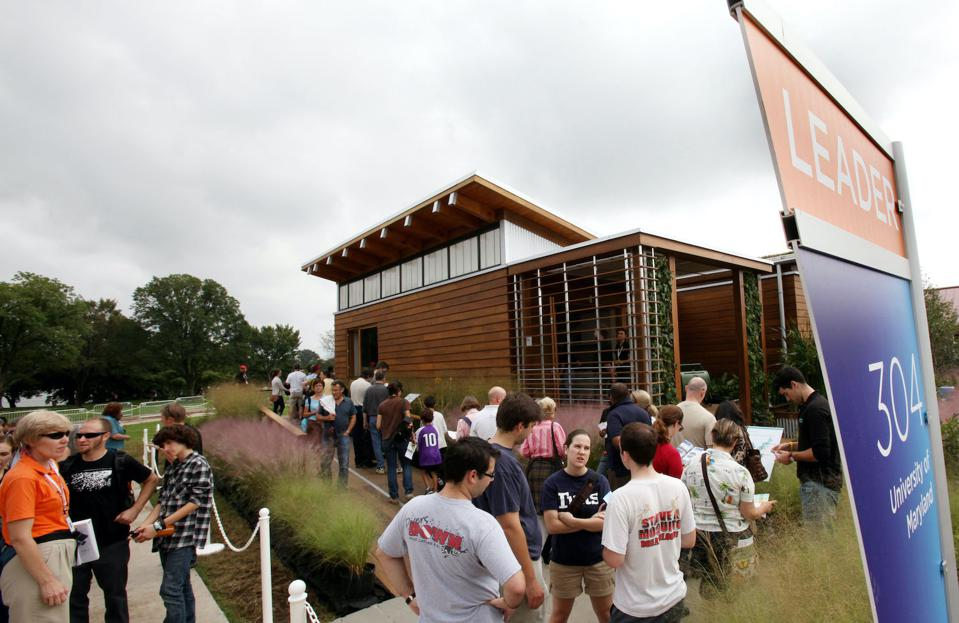 Visitors wait in line to tour inside the finished houses at the U.S. Department of Energy Solar Decathlon 2011 in Washington, D.C., Saturday, Sept. 24, 2011.