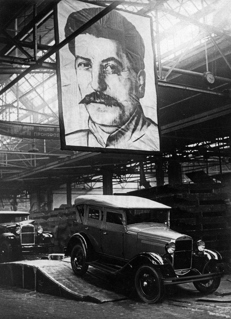 Automobiles (1929 ford type) leaving the assembly line of the molotov auto plant in gorky, ussr, 1930s.