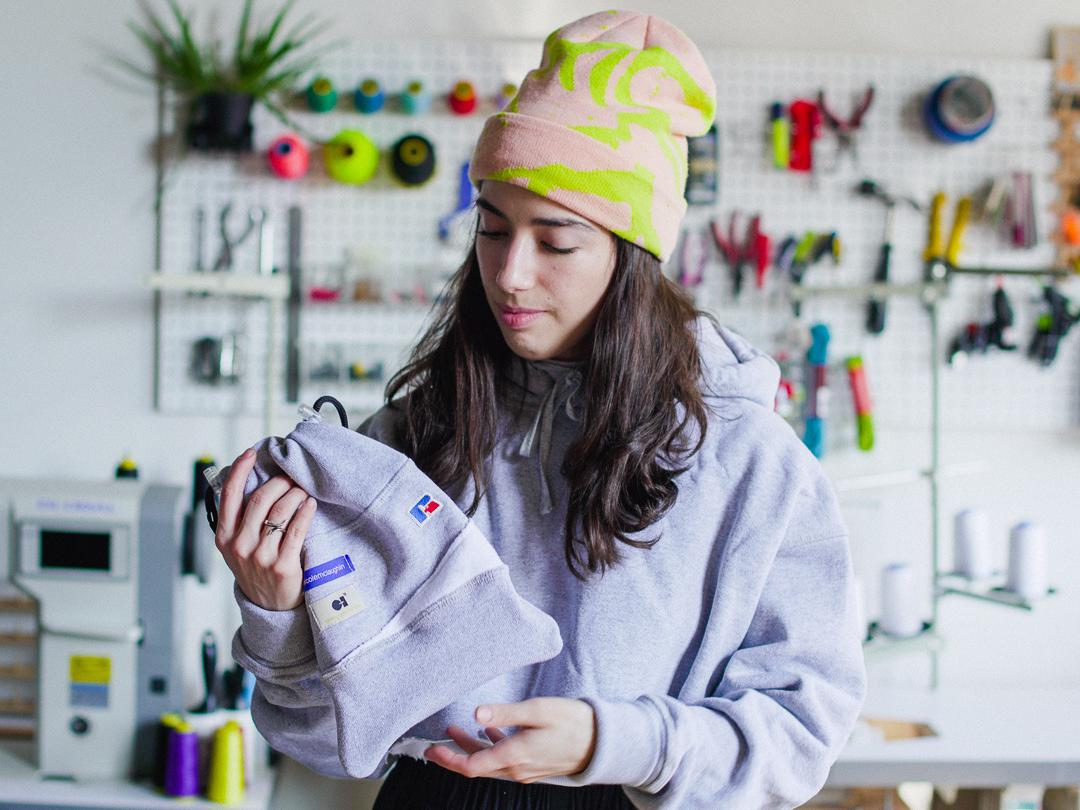 Working with knapsacks and snapbacks, McLaughlin brings her unique approach to upcycling.