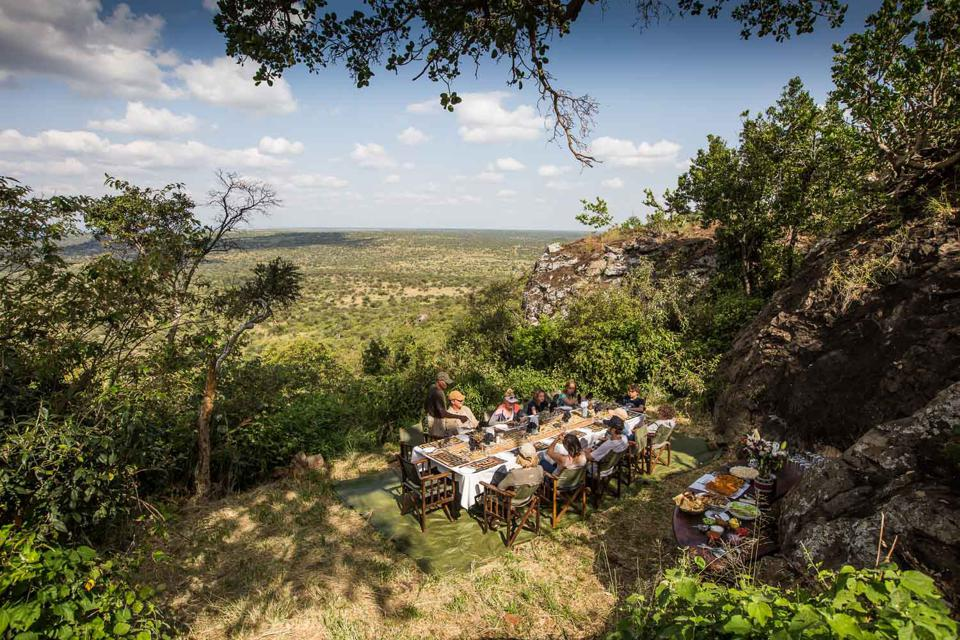 Dining outdoors while staying at Siruai Mobile Camp in Kenya.
