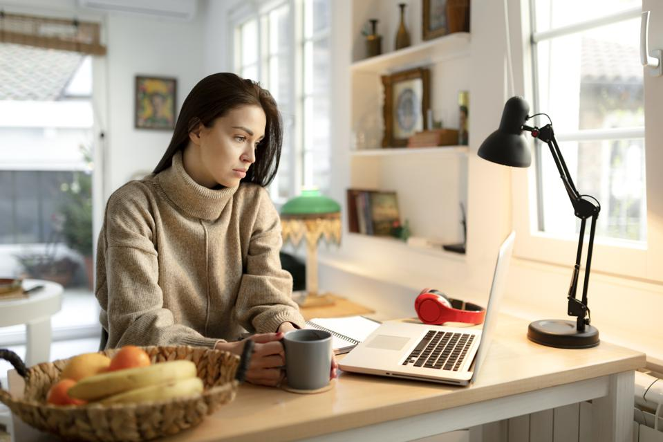 Young businesswoman feeling stressed while working from home