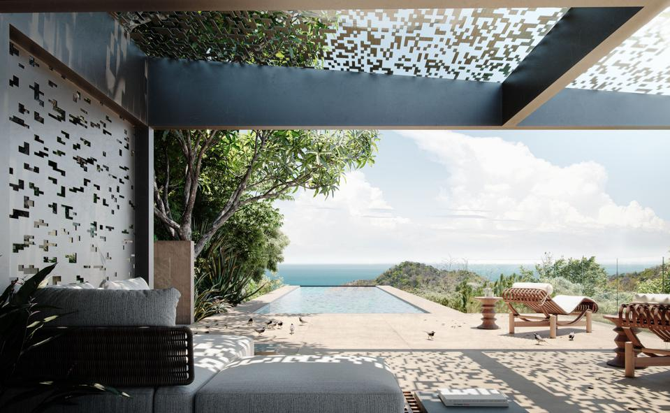 An outdoor lounge overlooking an infinity pool.
