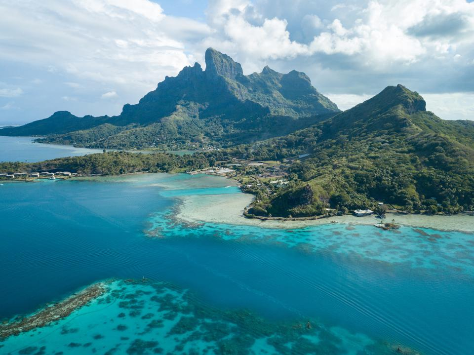 Aerial image from a drone of blue lagoon and Otemanu mountain at Bora Bora island, Tahiti, French Polynesia, South Pacific Ocean (Bora Bora Aerial)