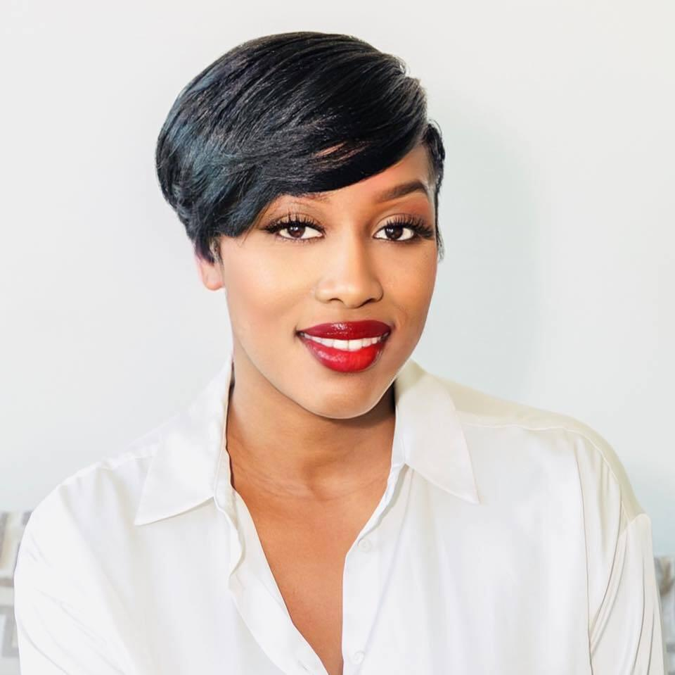 Netta Jenkins smiling with red lipstick and white collared shirt