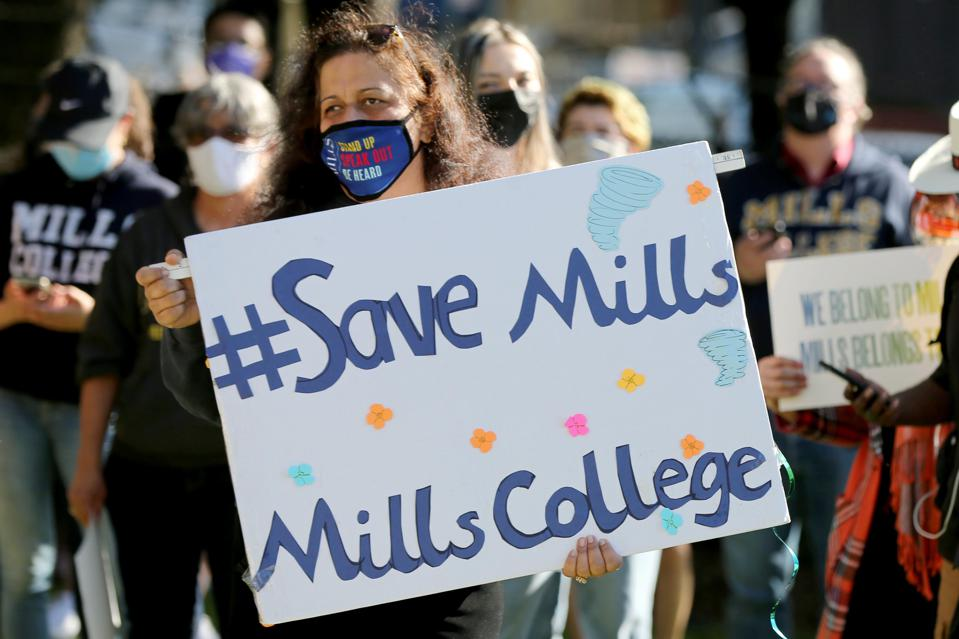 Former and current Mills College students rally to demand closure of school in 2023