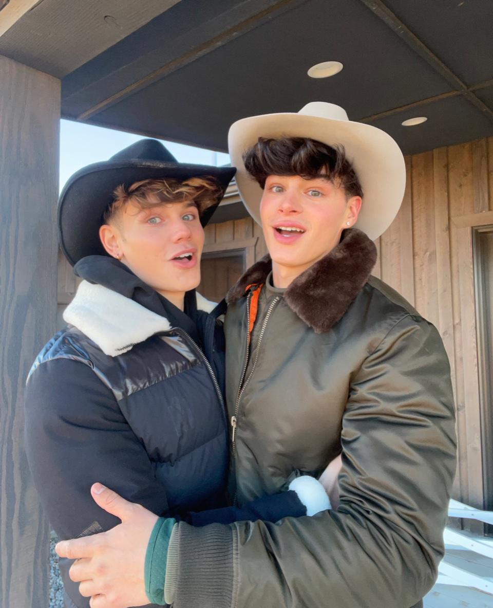 Nicky Champa (left) and Pierre Boo in an outdoor setting in jackets and cowboy hats