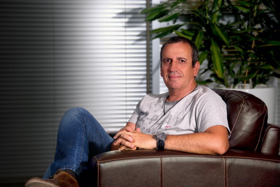 Eyal Waldman, the former CEO of Mellanox, sitting in a chair