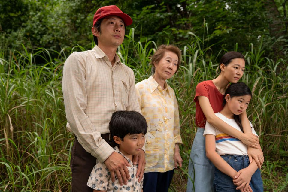 The cast of the film Minari standing together in a scene