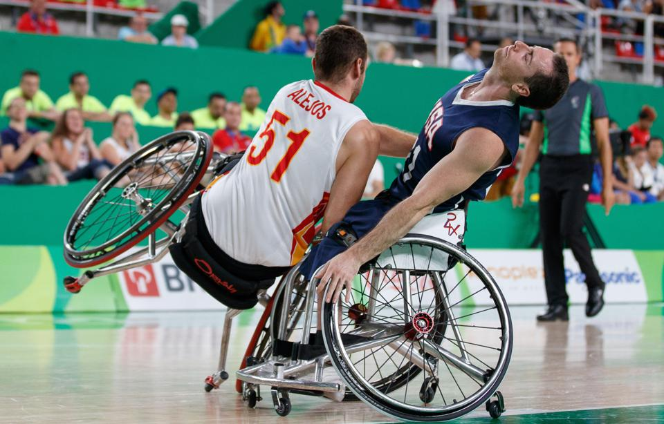 Serio and Agustin Alejos Alonso collide during a Paralympic Games