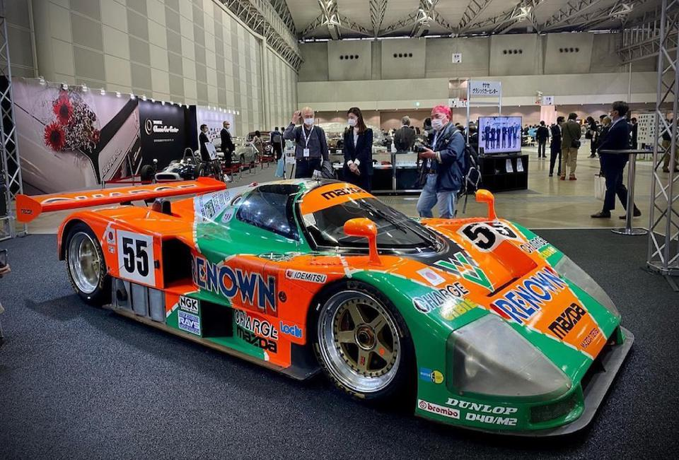 Mazda celebrates its 1991 Le Mans victory with a display of 3 race cars including the race-winning 787B seen here.