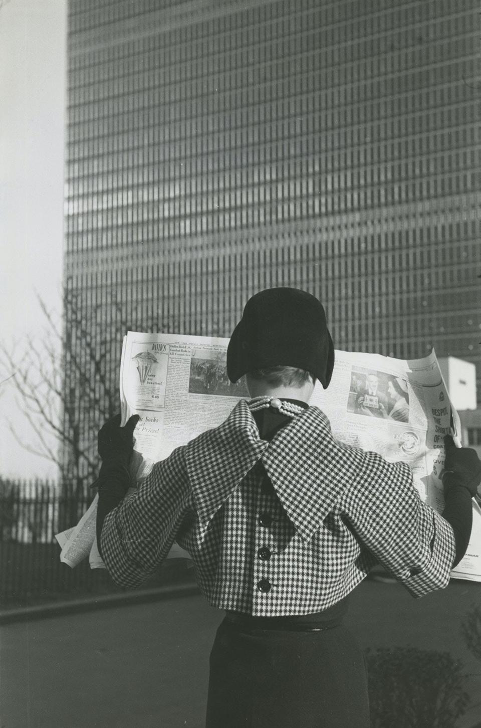 woman reading newspaper 1949