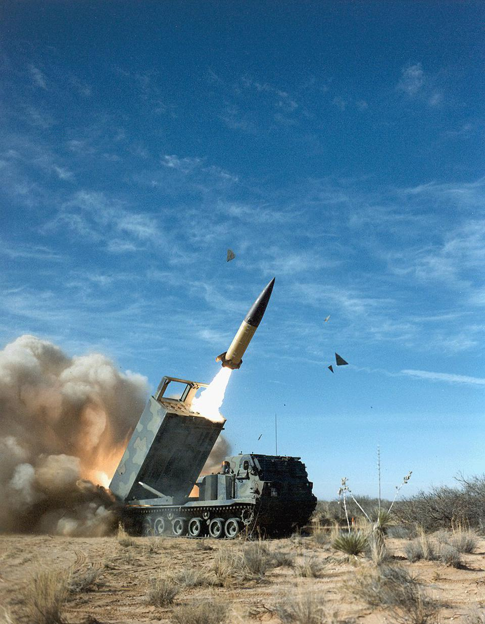 Missile launch in the desert against the backdrop of a blue sky.