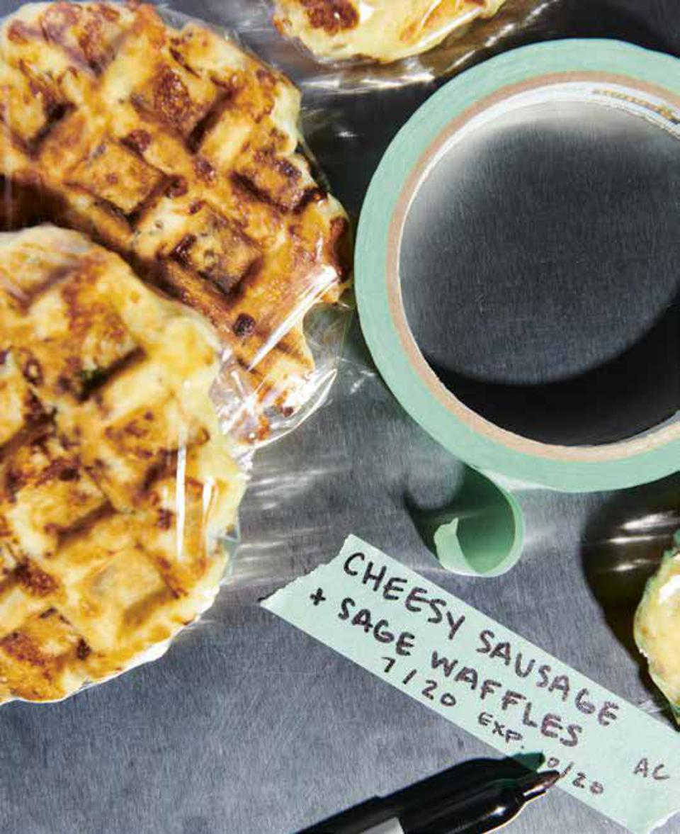 Cheesy Sausage and Sage Waffles from the new cookbook, ″It's Always Freezer Season″ are wrapped individually and labeled before being frozen.