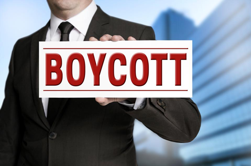 boycott sign is held by businessman