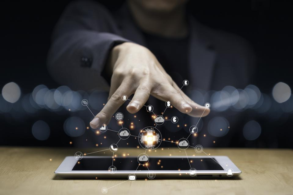 Businessman hand create artificial intelligence for technology transformation and internet of thing on tablet. Cloud technology will management big data include business strategy , customer service.