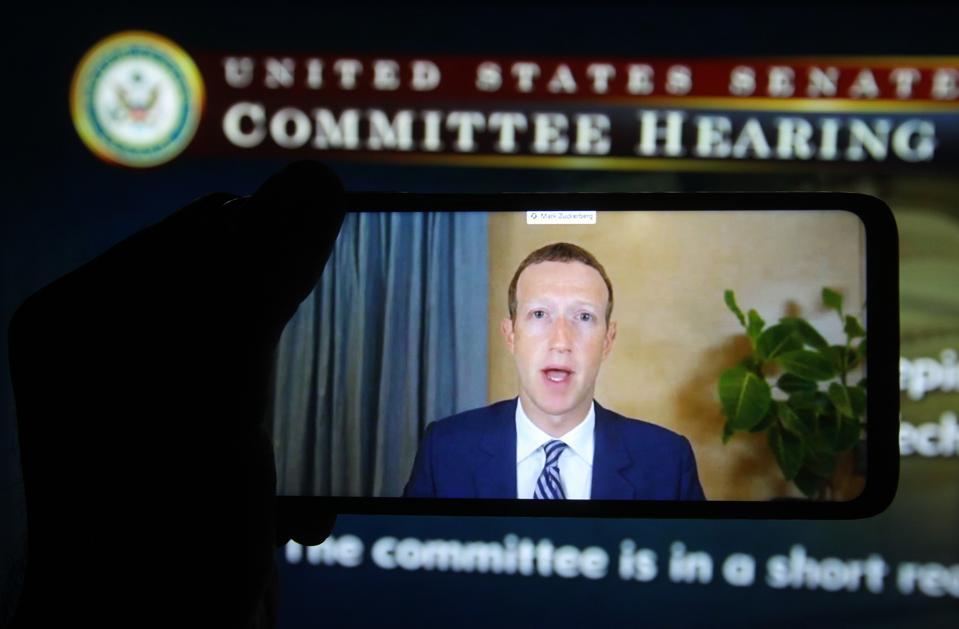 In this photo illustration, Facebook CEO Mark Zuckerberg...