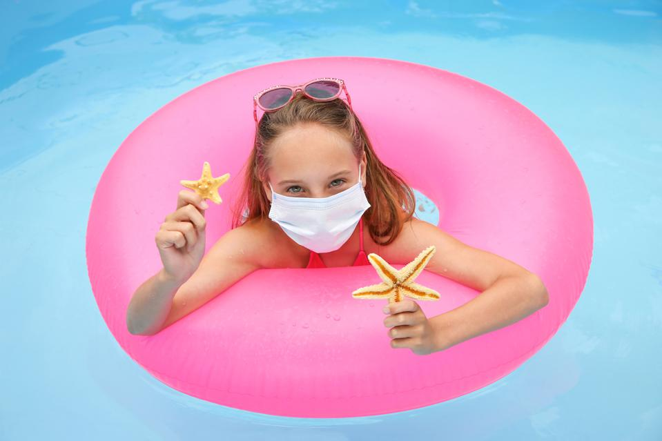 A very crowded swimming pool is probably a no-no, say epidemiologists