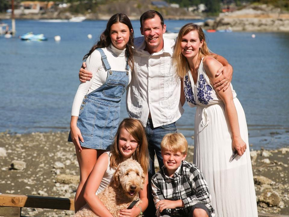 Family photo of McCarron with husband, 3 kids and dog.