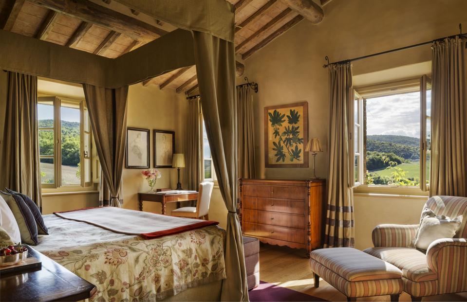 Master bedroom in one of the opulent villas at Rosewood Castiglion del Bosco
