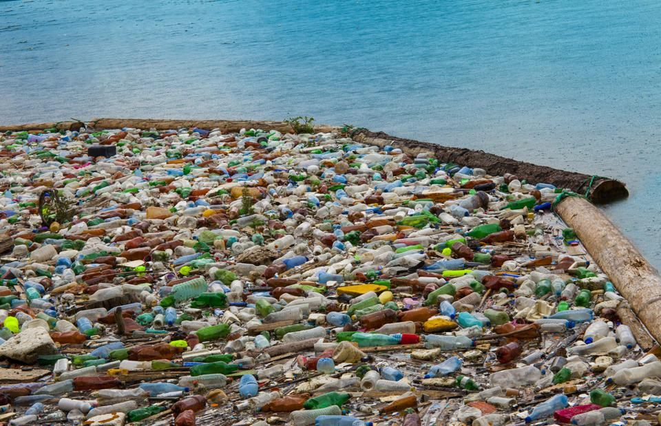 A patch of floating plastic debris on top of a body of water.