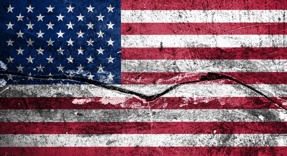 Concept American flag on cracked background