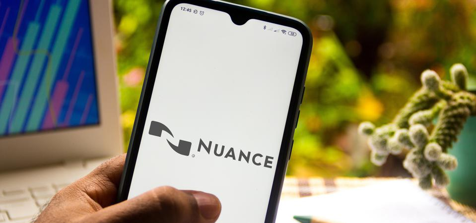 In this photo illustration the Nuance Communications logo...
