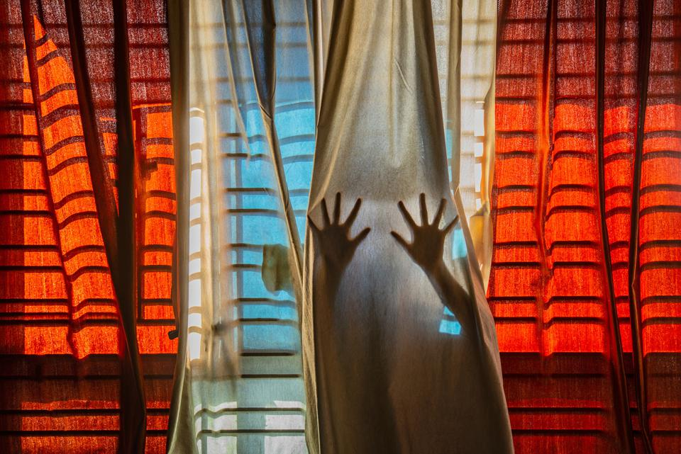 curtains with hands behind