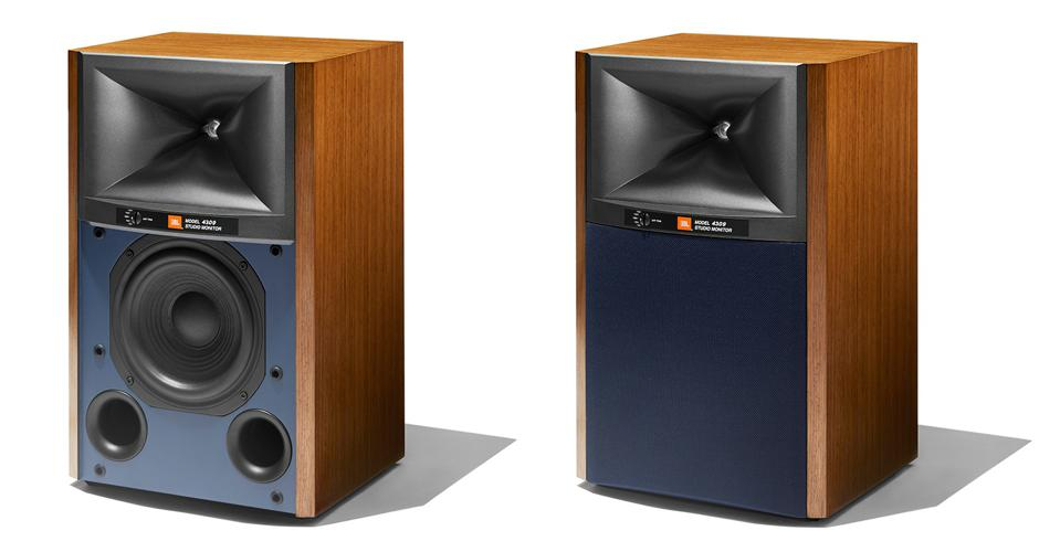 Front view of two walnut JBL 4309 one with grille removed